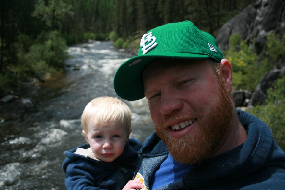 Land and his son Colin on a river in Montana.
